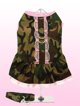 Camouflage Harness Dress & Lead - A trendy, urban influenced camouflage harness dress. The main body of the dress has a green, brown and black camouflage pattern. What makes it really special is the pretty pink lace edging around the pleats. The dress has two velcro fastenings underneath that make it easy to put on and take off. The...