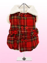Red Highland Tartan Fleece-Lined Coat - Get with the highland tartan trend and dress your precious pup in this delightful coat. The top-fastening buttons make it easy to dress your pup and add to the look of the coat. While, the box pleats and bows make this coat just too cute for words! The soft lining will keep your pup lovely and warm.