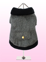 Elegant Grey Herringbone Coat - This is a richly textured elegant coat for the true lady, created in a herringbone  blend. Giving a nod to the traditional pea coat with its neat collar and buttoned cuffs, this short length jacket sits perfectly and is great for day or evening. Finished with a black collar and hem and beautifully l...